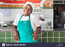 a kitchen hand waitress at work in salvador bahia stock photo a kitchen hand waitress at work in salvador bahia
