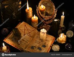 mystic background with old book skull candleirror and occult concept black magic ritual there is no foreign text in the image