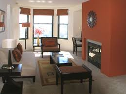 warm orange living room colors. warm orange accent wall living room colors