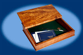 the lap desk is made of beautiful solid curly maple with brass hinges and finished in a golden er sheen lacquer it features a generous storage area
