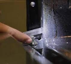 how to remove a cooker oven door