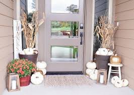 love this fall decorating by the diy mommy first of all her front door wreath is not the typical fall decor we love that it can transition into winter