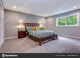cozy bedroom colorful bed built closet stock photo