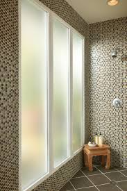 DESIGN TIPS: In the bathroom shower, obscure glass offers privacy while  letting in light
