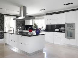 kitchen design white cabinets black appliances. Simple Cabinets This Striking Contemporary Kitchen Utilizes Black Counters And Bold Accent  Wallpaper To Break Up The On Kitchen Design White Cabinets Black Appliances
