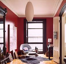 red room with black furniture. red paint with dark trim room black furniture
