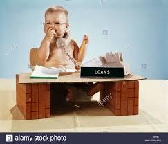 1960s baby businessman diaper sitting at loan desk wearing eyegl talking on telephone
