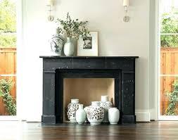pictures of black fireplace mantels black fireplace mantel black marble fireplace mantel with green vases dark