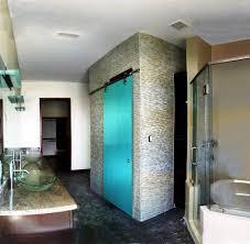 dorma manet sliding bar door made of back painted glass at closet in bathroom sliding