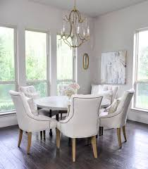 bright breakfast nook with round six seat table 3