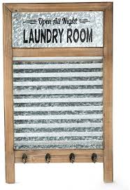 If that's true of you, then chances are you've got a beautiful piece of statement furniture and a lot of bare walls. Amazon Com Emax Home Large Farmhouse Metal And Wood Washboard With Towel Hooks For Laundry Room Vintage Laundry Room Wall Decor Sign With Galvanized Memo Board 24 75 X 15 Home Kitchen