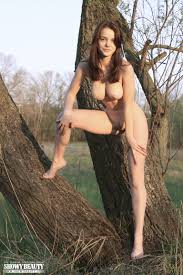 Fascinating Busty Teen Peach Undressing And Spreading Her Long Slender Legs On The Logs