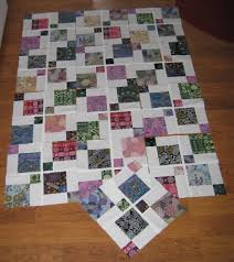 Disappearing 9-patch (Australia Quilt part 2)   Nita Collins & And here's another disappearing 9-patch quilt top done the regular way  (without the spacing strips): Adamdwight.com