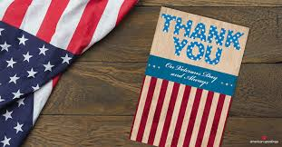 thank you veterans day card next to an american flag