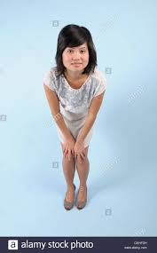 Asian on her knees