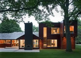 Midcentury modern wood flat roof idea in Kansas City