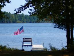 Image result for American flag over a lake