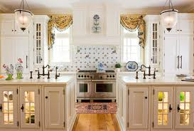 The All White Kitchen Allows Colorful Patterns On The Tiled Backsplash,  Windows, Rug, And Dishes In The Lighted Islands To Get The Attention They  Deserve.