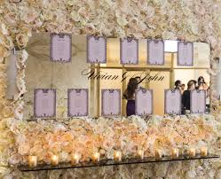 Wedding Planner Wall Chart Ivory Flower Wall Seating Chart With Mirror Real Wedding