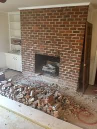 the original fireplace was made from 1970s era red brick and looked a little dated