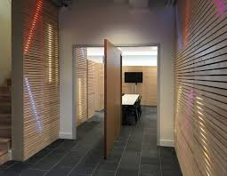 wooden pivot doors pivot door towards a conference room fritsjurgens