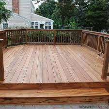 a free standing platform deck showcases exotic hardwood decking and rails for an outdoor space