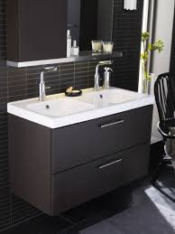 small brown wooden bathroom vanity design with double white modern sinks and stainless steel floating rack with wall mirror