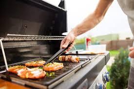 a man grilling food