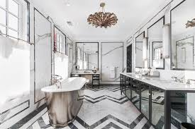Black and white bathroom features a black double washstand fitted with  mirrored cabinet doors topped with white marble framing his and hers sinks  under ...