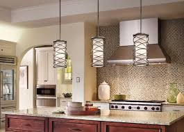 when hanging pendant lights over a kitchen island like these kichler corporate krasi pendants