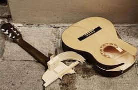 hang a guitar on the wall tips and