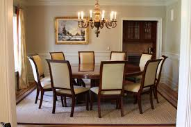 modern dining room design with wooden expandable round dining table and dining chairs also chandelier