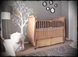 nursery room ideas with wooden crib and grey wall paint also wooden laminate flooring and white