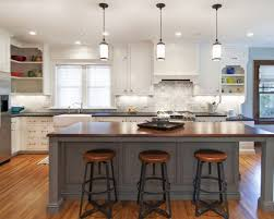 brown white kitchen theme color including pendant lighting over island and  wooden floor for lively comfortable
