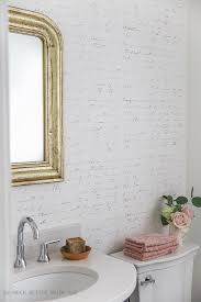 black white french bathroom makeover french gold mirror french script stencilled wall vanity