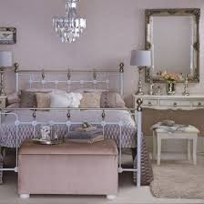 feng shui bedroom mirror in room with wrought iron double bed dressing table