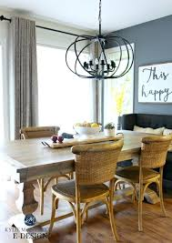 round chandelier over rectangular table round lamps
