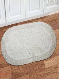 solid oval shaped bath rug
