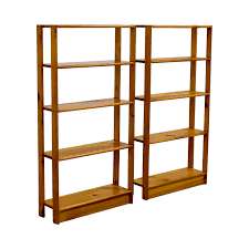 slim light brown wooden bookshelves