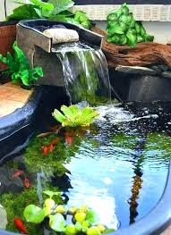 small garden pond fish ponds rock waterfall flowing in to with lily pads backyard kits waterfalls garden pond