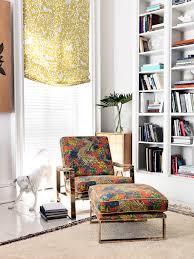 window treatment is pantheon in dandelion chair and ottman are ming dragon in persimmon robert allen fabricroom
