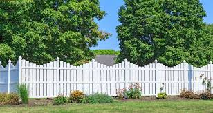 vinyl fence designs. A Lovely White Vinyl Picket Fence With Delicate Scalloped Silhouette. Small Planting Bed Designs