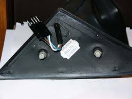 remove the 2 bolts holding the mirror in place while providing support so the mirror assembly doesn t fall disconnect the wiring harness and the mirror