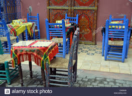 brightly painted furniture. Little Moroccan Cafe With Brightly Painted Chairs; - Stock Image Furniture