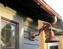 the neighborhood we live in has a nautical history so the copper is a nod to this plus it will age well in the salt air she notes we chose barn lights
