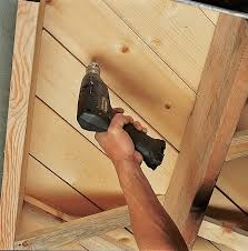 if you can access floor joists from underneath drive wood s up through the suloor to draw hardwood flooring and the suloor together