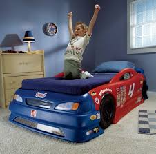 Mesmerizing Red And Blue Car Bed Plan For Kids Featuring Wooden Storage  Cabinet And Drawers And White Carpet