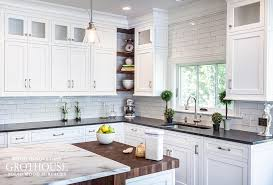 black and white kitchen design by stonington cabinetry designs includes a butcher block
