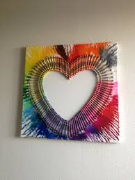 hot glue all the crayons you want in a heart shape on a 8 by 8 square canvas then bring out your hair dryer and turn on your hair dryer to
