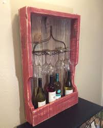Rustic wine rack from pallet wood and fence pickets with rusty rake